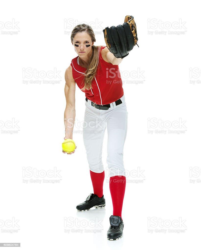 Softball player throwing a ball stock photo