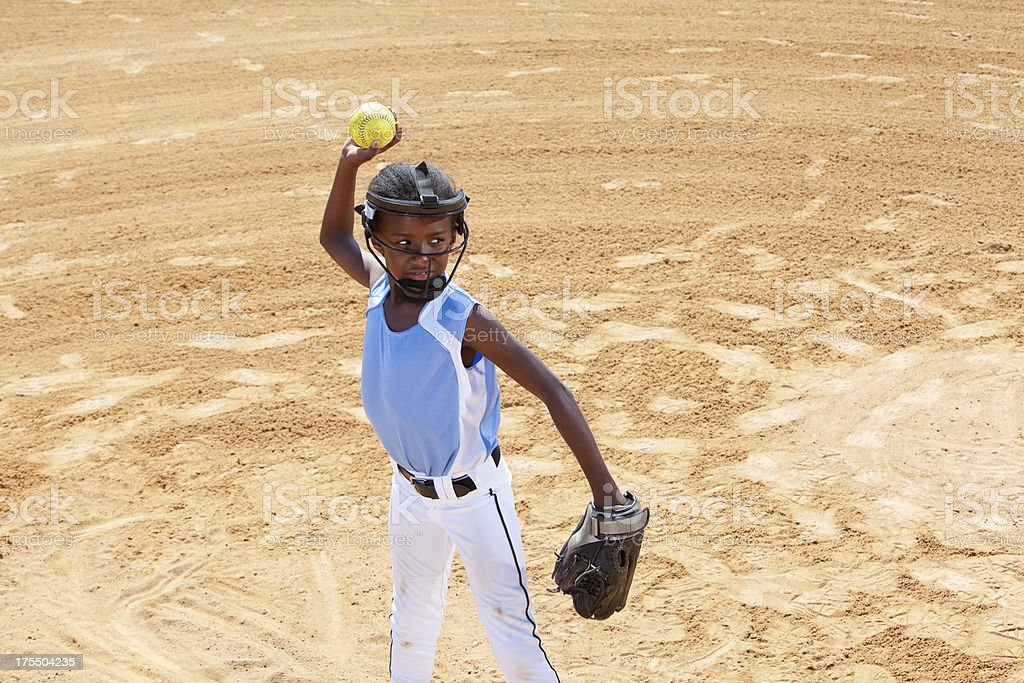 African American girl , infield player, throwing softball. Wearing...