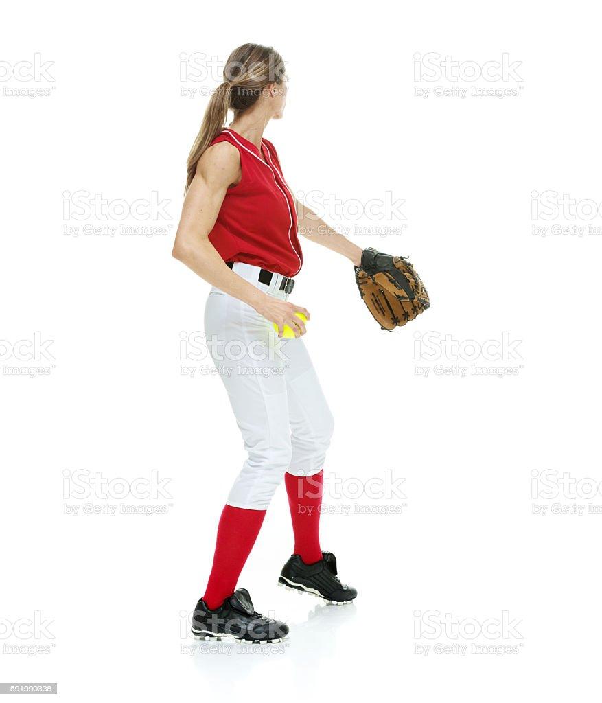 Softball player throwing ball stock photo