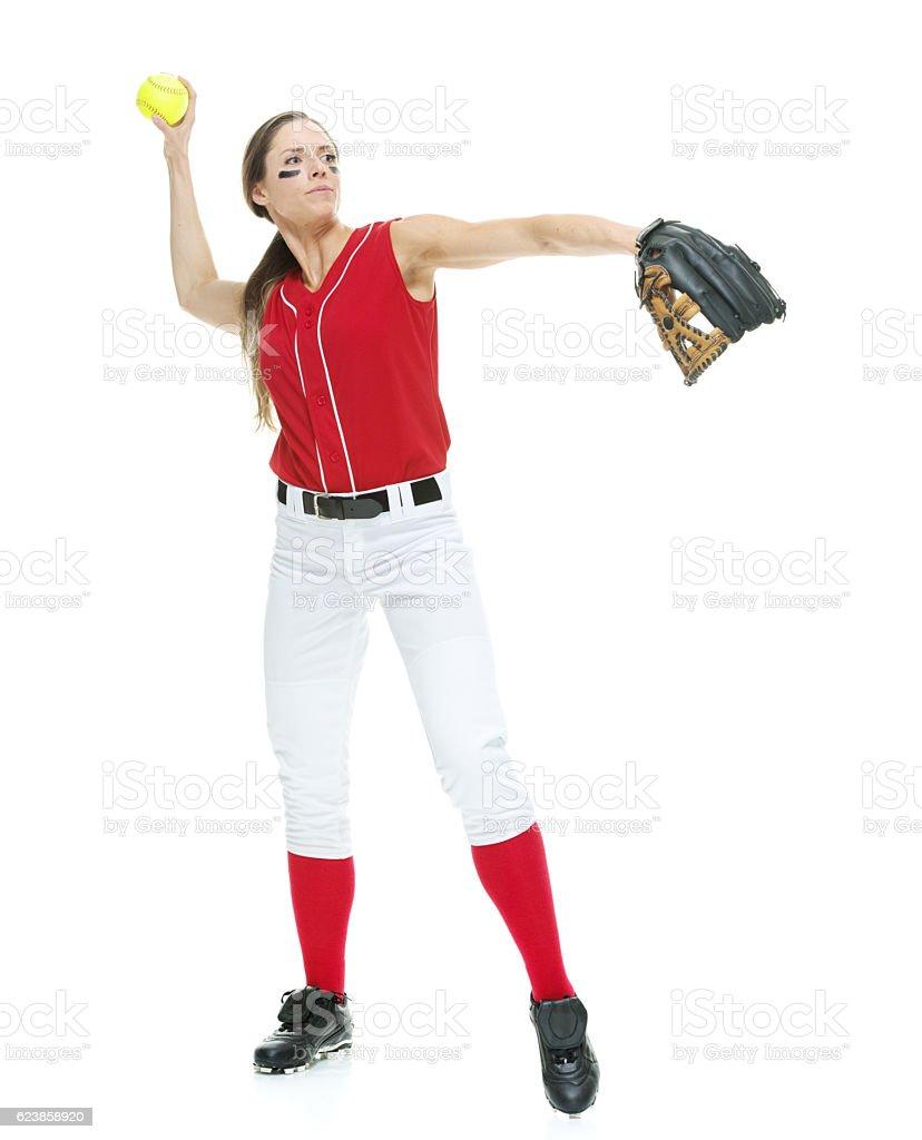 Softball player throwing stock photo