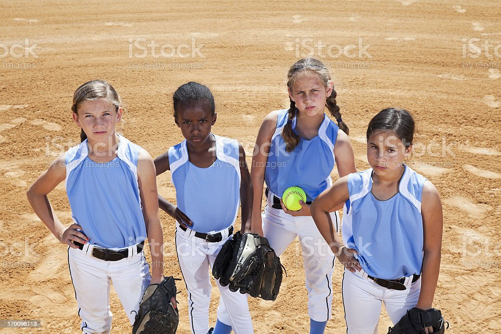 Girls playing softball.