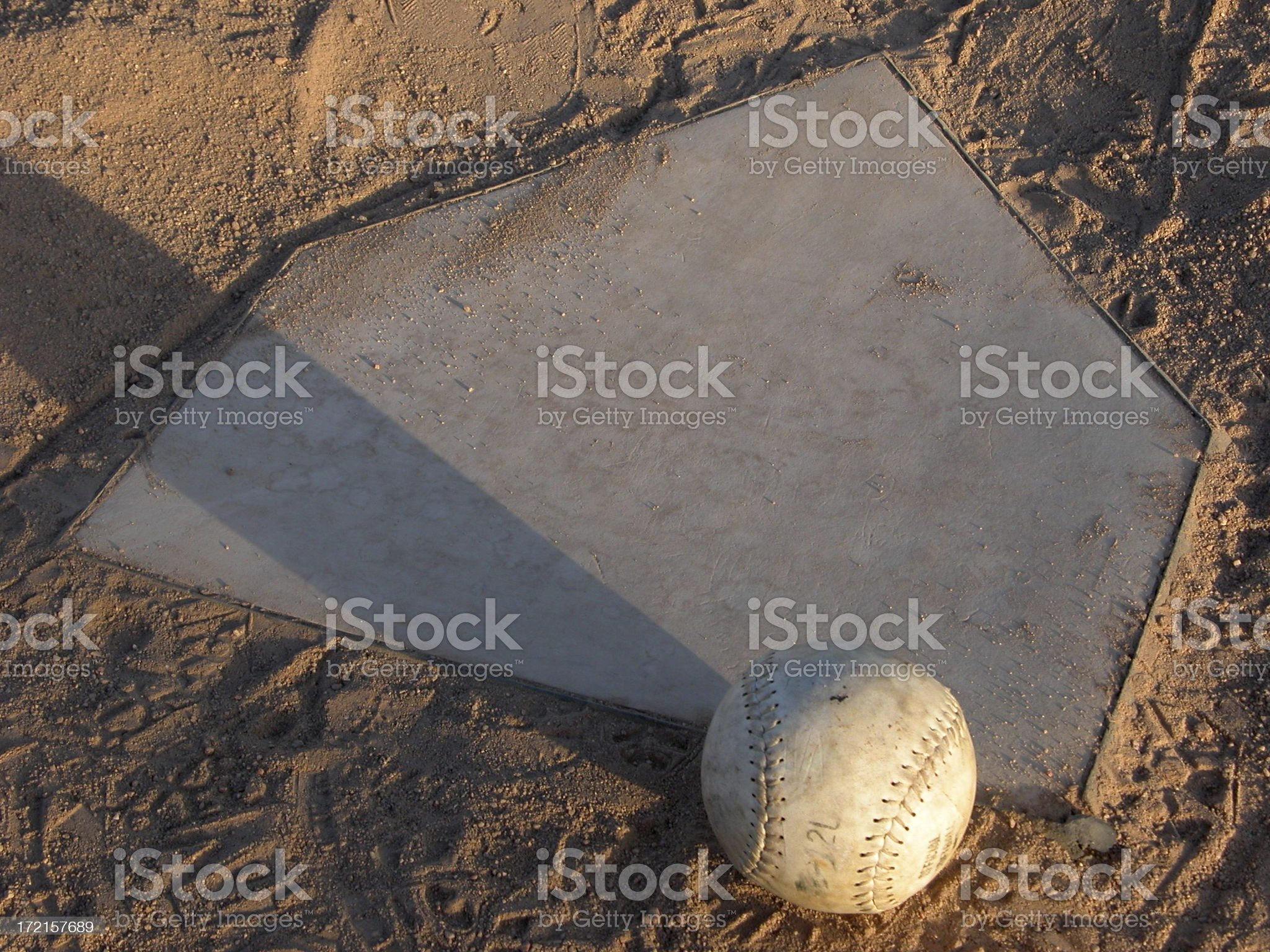 Softball Resting on Home Plate royalty-free stock photo