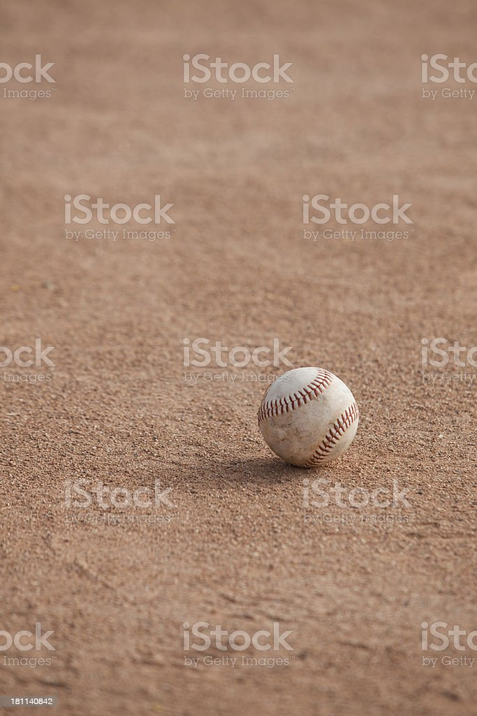 Softball sitting on the infield dirt royalty-free stock photo