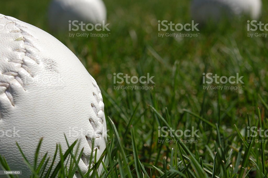 softballs in the grass