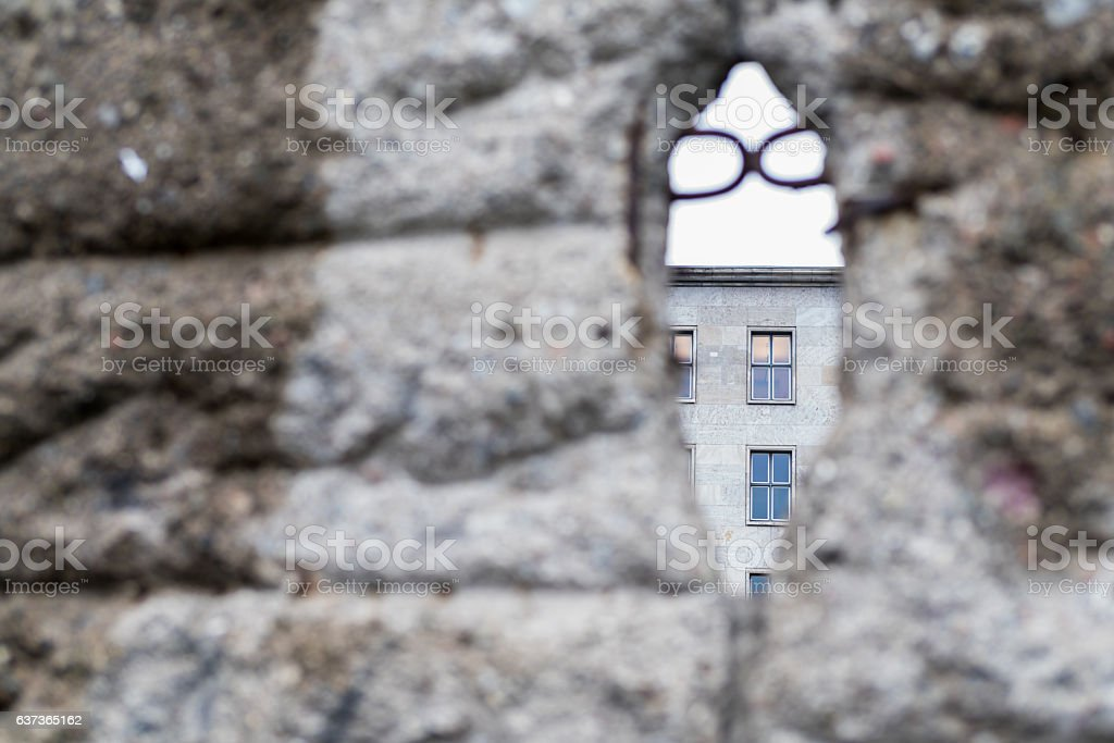 Soft-focus view of crumbling Berlin Wall with civillian building focus stock photo