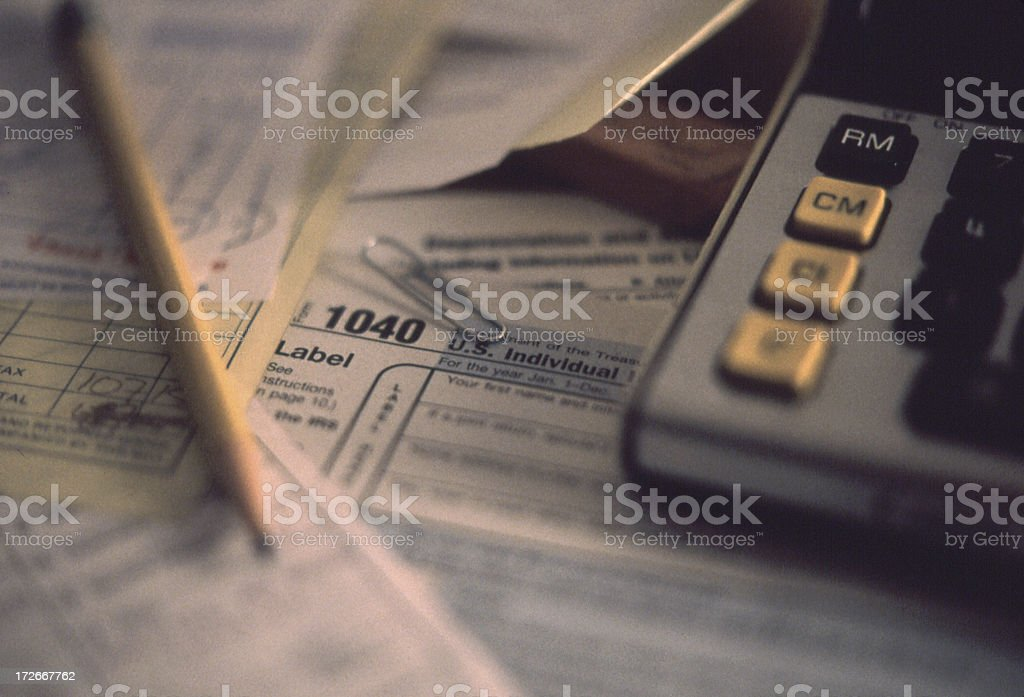 Softly lit closeup of tax preparation documents royalty-free stock photo