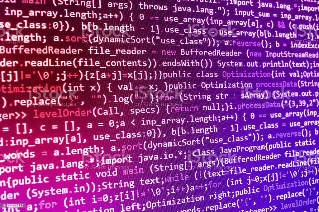 Software developer programming code on computer stock photo