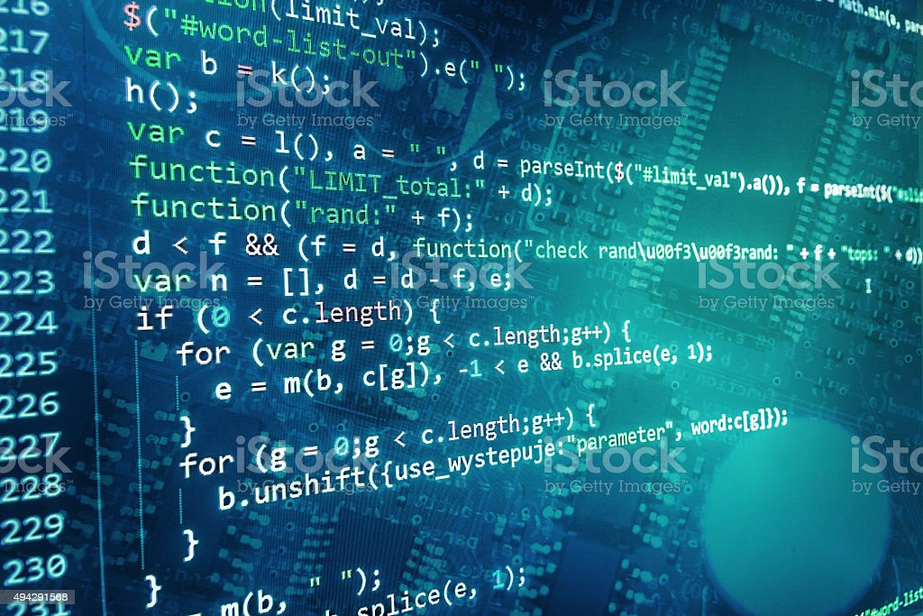 Software developer programming code on computer stock photo