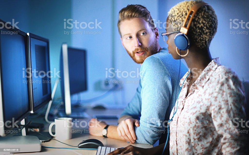 Software developers solving a problem. stock photo