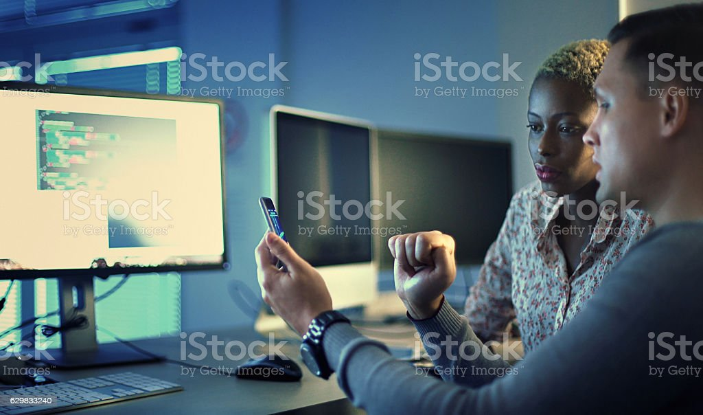 Software developers working late. stock photo