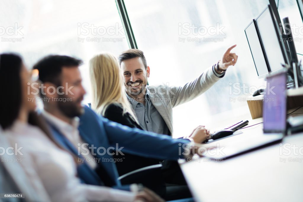 Software engineers working in office on project together stock photo