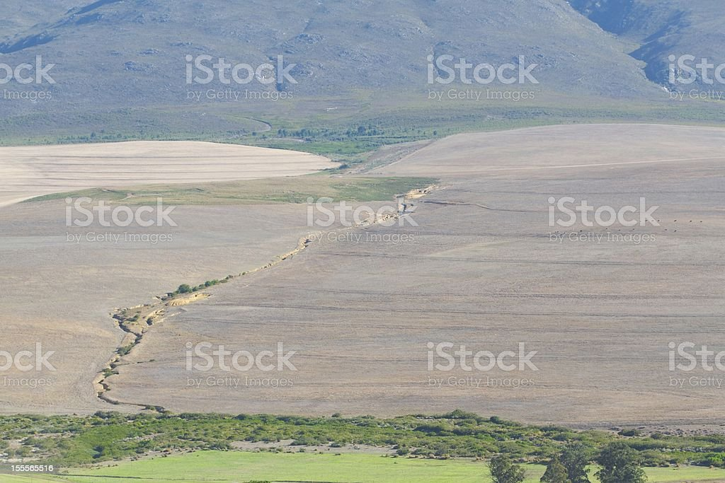 Soil Erosion in Fields at the Foot of a Mountain stock photo