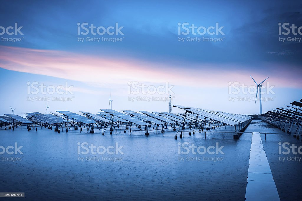 solar and wind power in bad weather stock photo