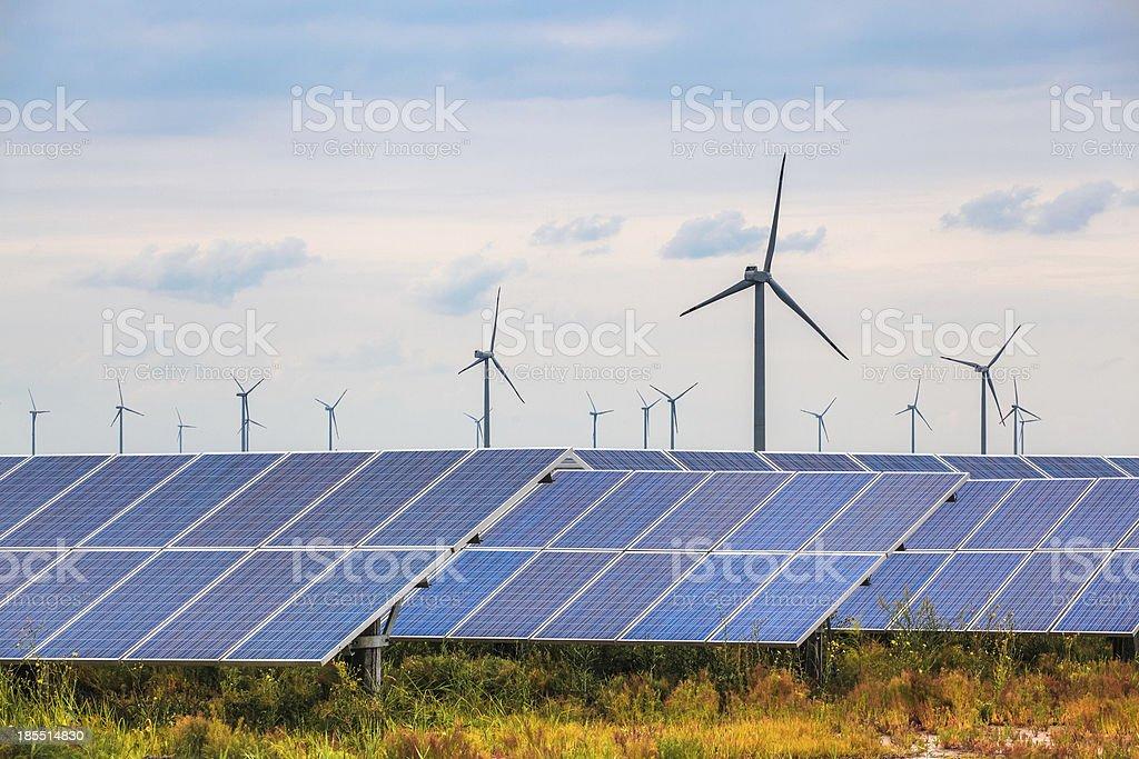 solar and wind power in coastal mud flat stock photo