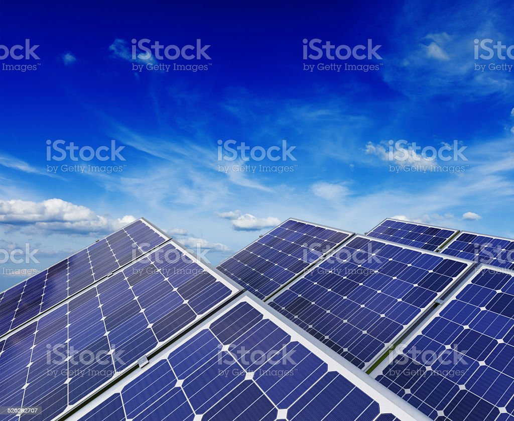 Solar battery panels under blue sky stock photo