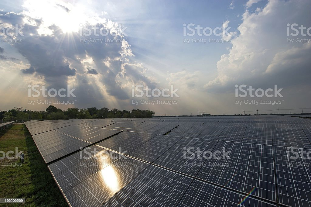 Solar cell over  blue sky and reflect the sun. royalty-free stock photo