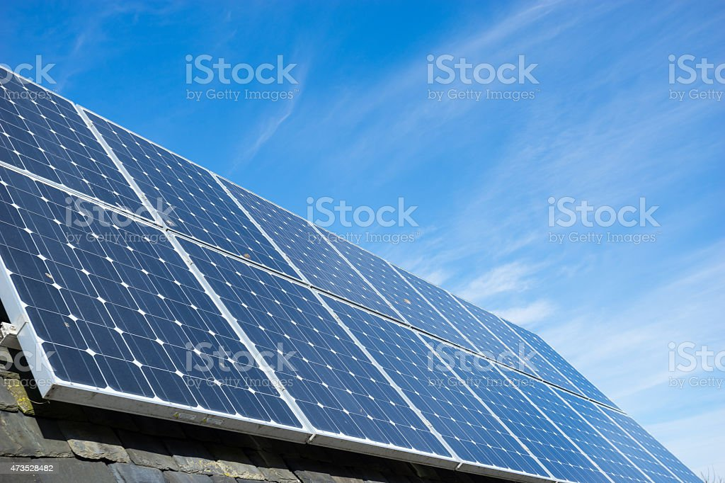 solar cell panel on house's roof, green energy stock photo