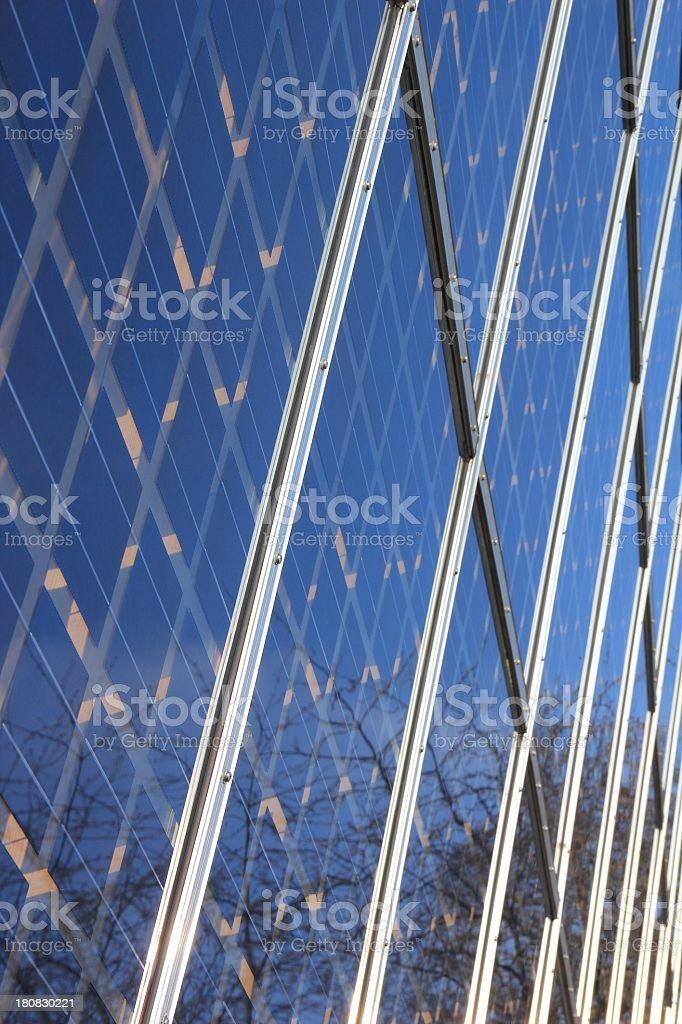 Solar cells behind window stock photo