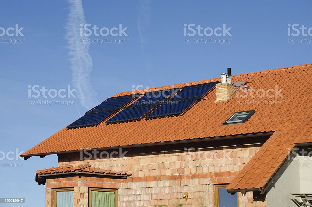 Solar collector on roof royalty-free stock photo