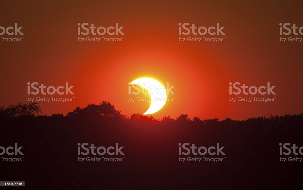 Solar Eclipse Sunset with Trees stock photo