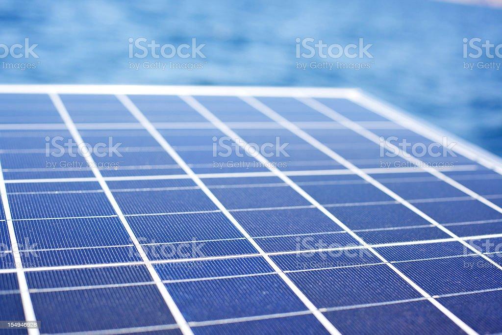 solar energy panel water background stock photo
