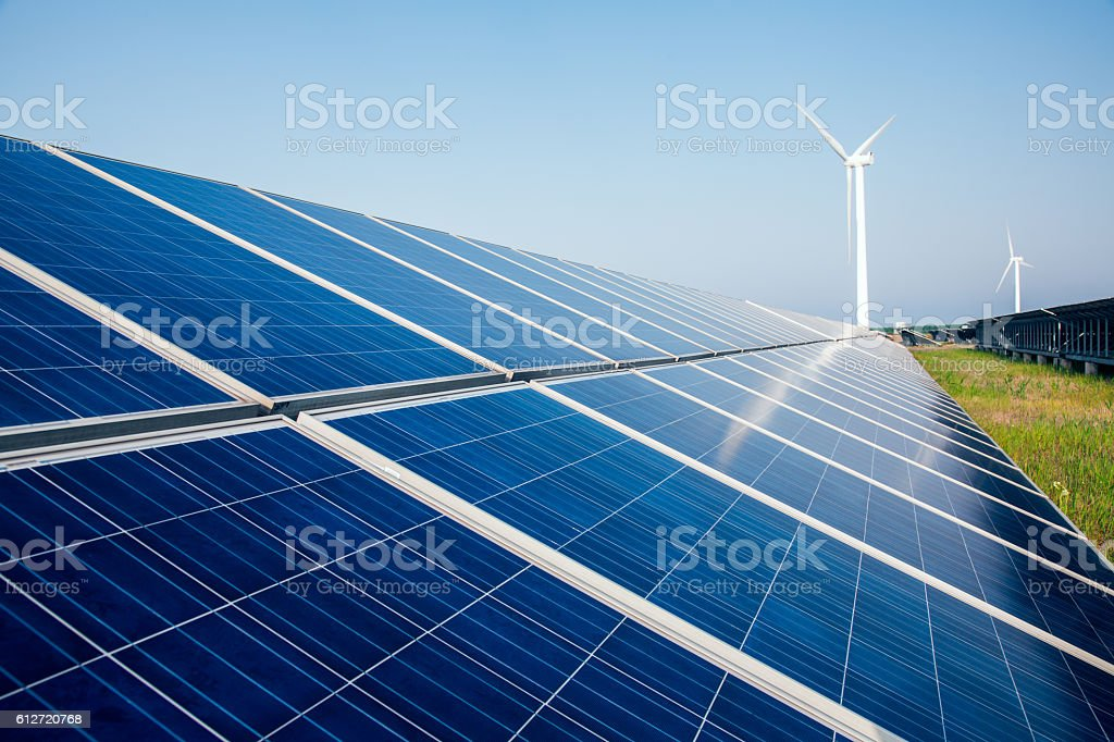 solar energy panels and wind turbine stock photo