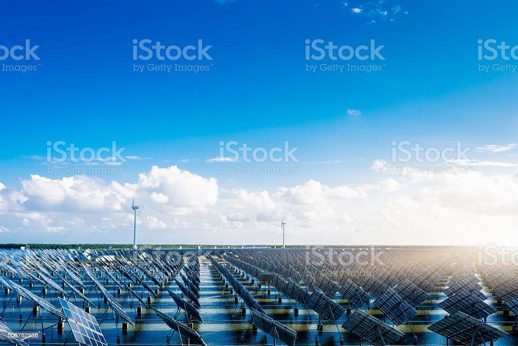 solar energy panels and wind turbines stock photo