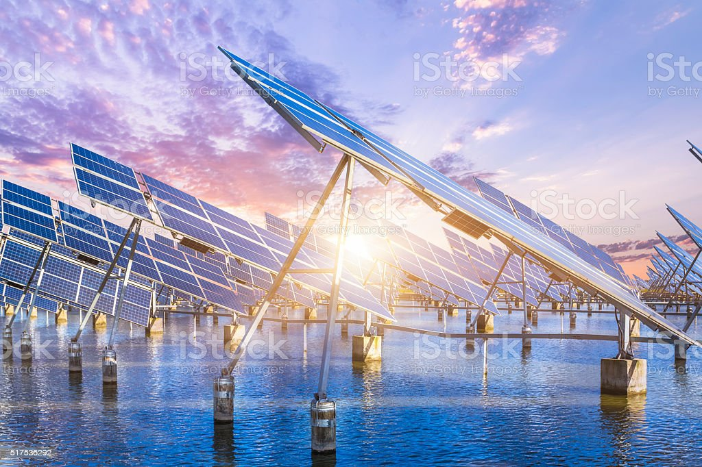 solar energy panels and wind turbines stock photo