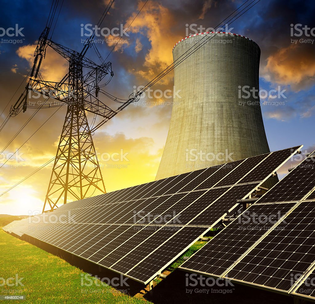 Solar energy panels, nuclear power plant and electricity pylon stock photo