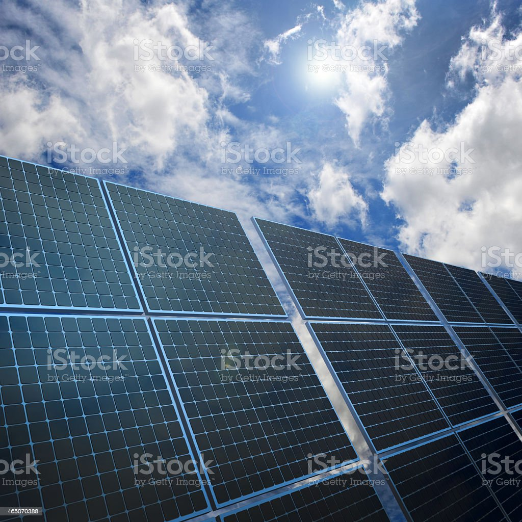 Solar energy panels on nice sky background with white clouds stock photo