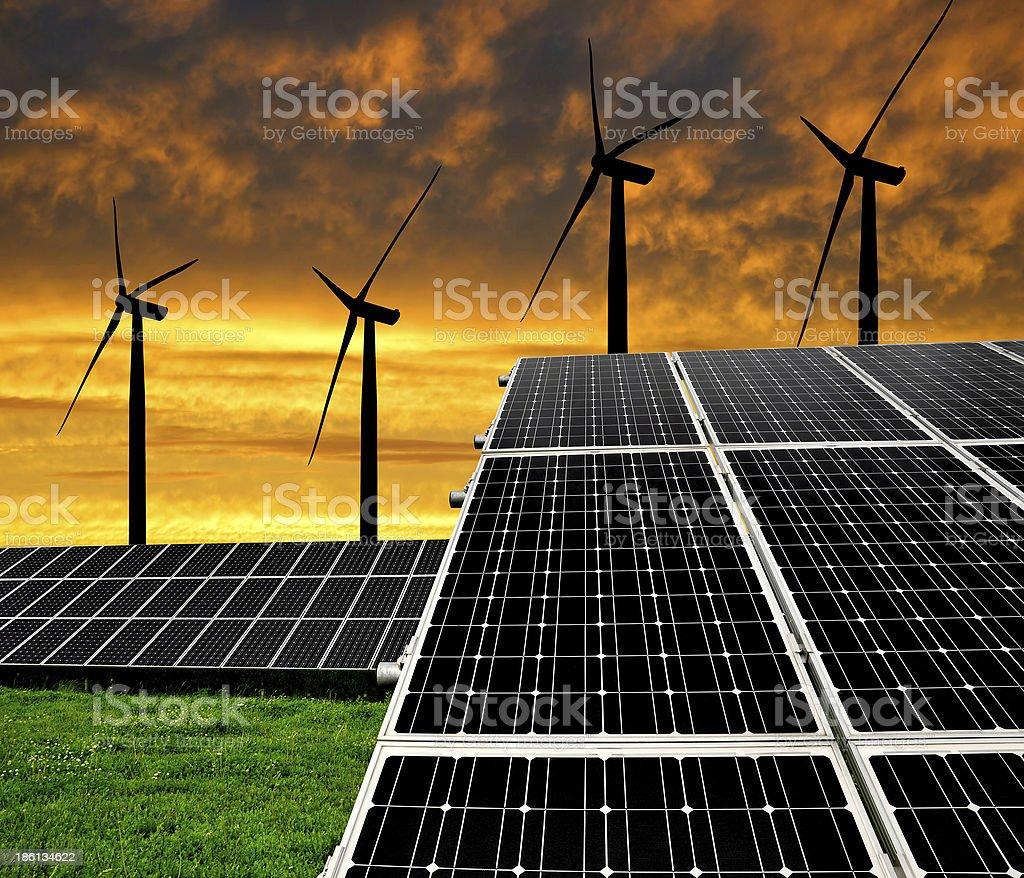 Solar energy panels with wind turbines royalty-free stock photo