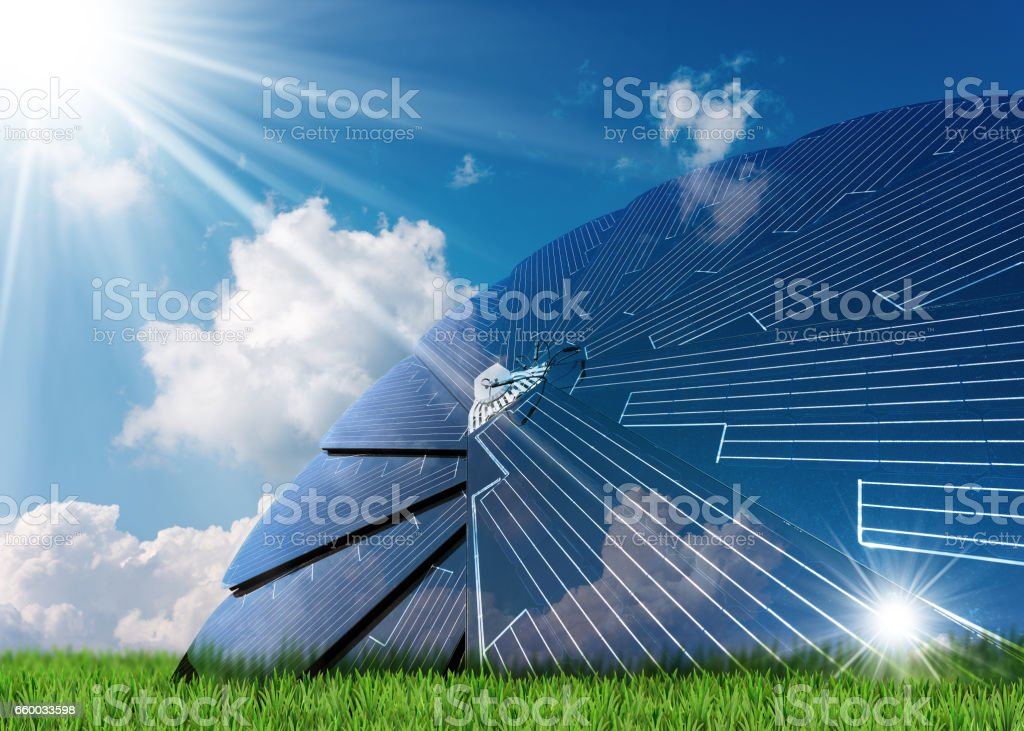 Solar Energy - Solar Panel on Green Grass stock photo
