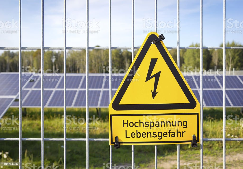 Solar Energy with Danger Sign stock photo