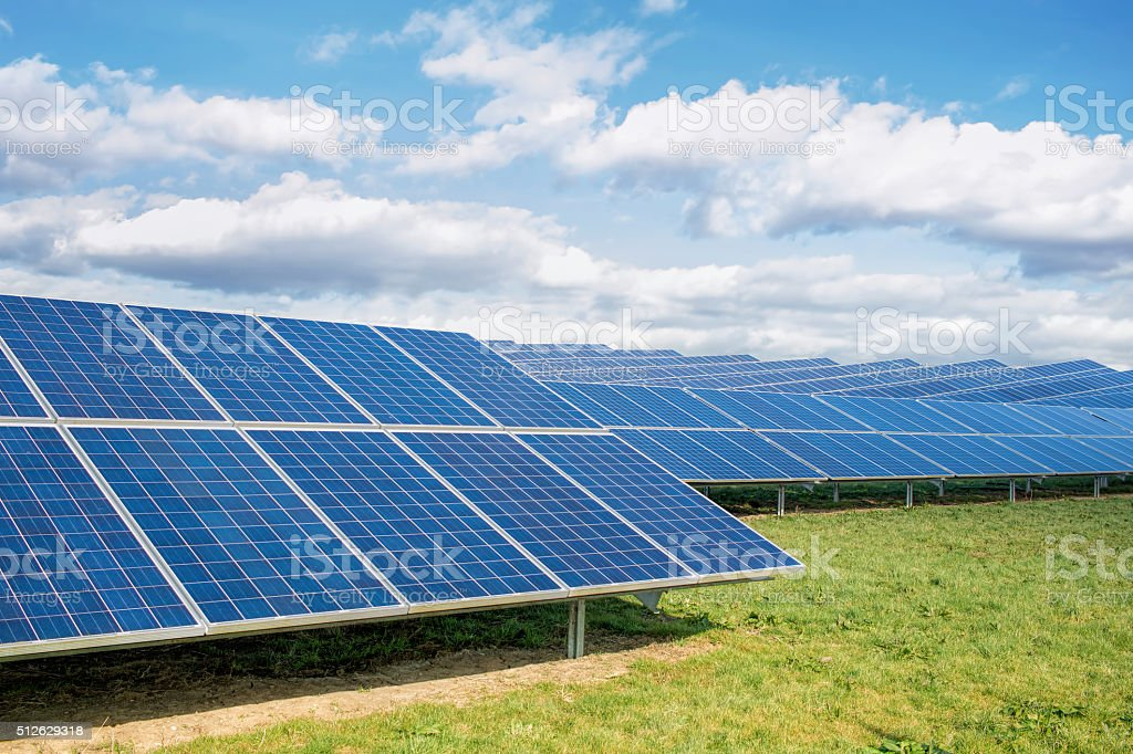 Solar Farm. Green Fields Blue Sky, Sustainable Renewable Energy. stock photo