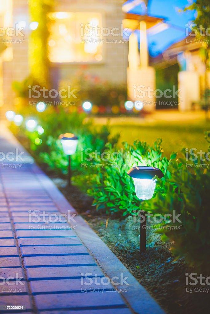Solar Garden Light, Lanterns In Flower Bed. Garden Design stock photo