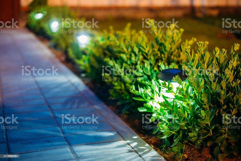 Solar Garden Light, Lanterns In Flower Bed. Garden Design stock photo