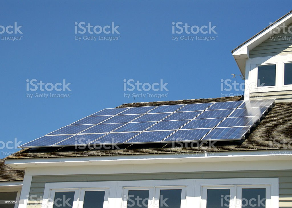 Solar generation from roof panels royalty-free stock photo