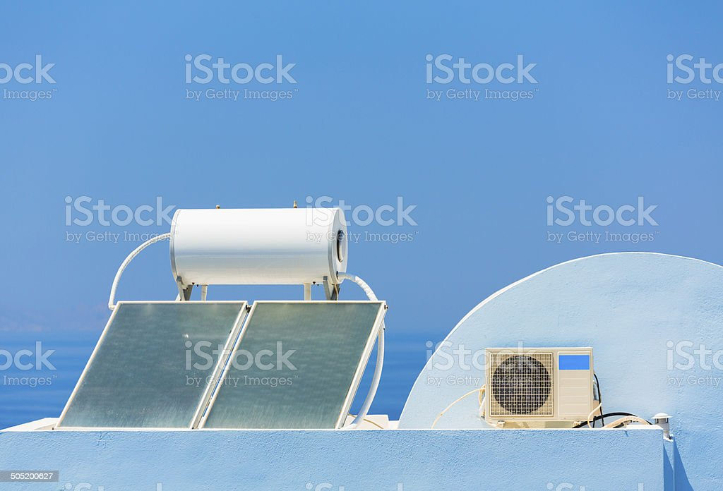 Solar heater and air conditioner on a roof in Greece stock photo