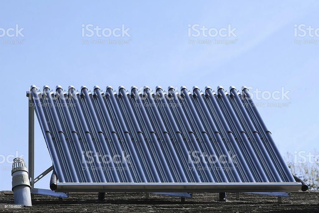 Solar heating panel against blue sky stock photo