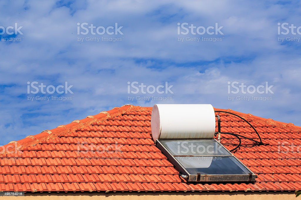 Solar heating system on the tile roof stock photo