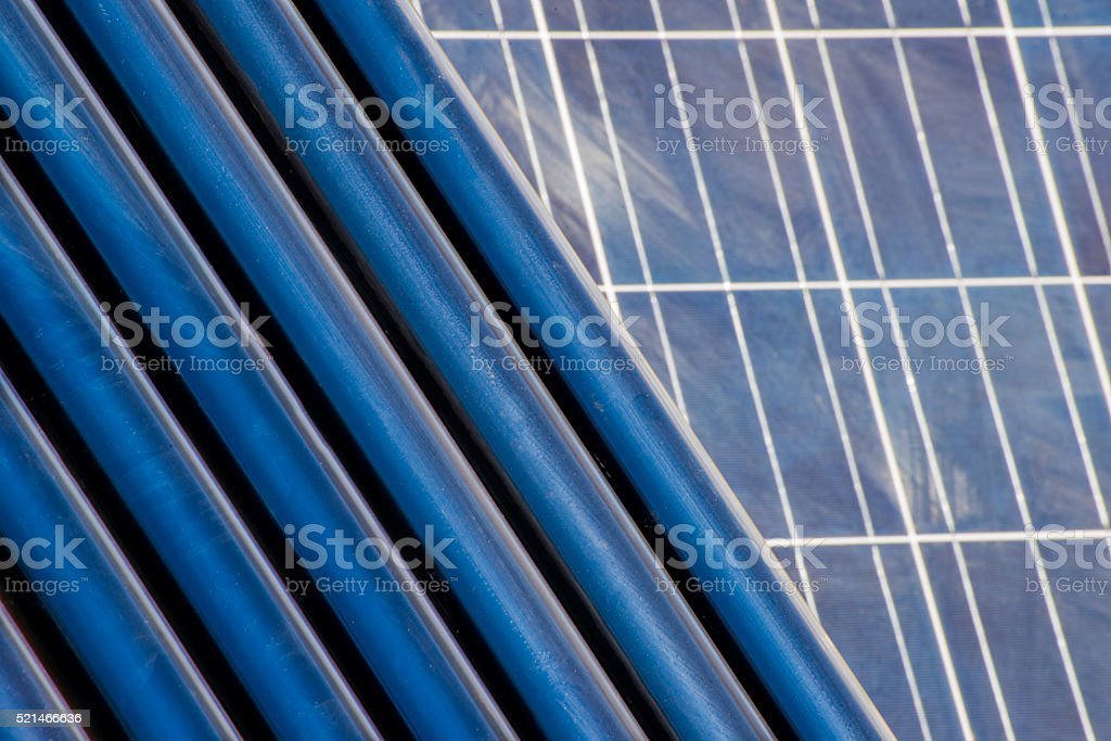 Solar heating tubes in front of a solar panel stock photo
