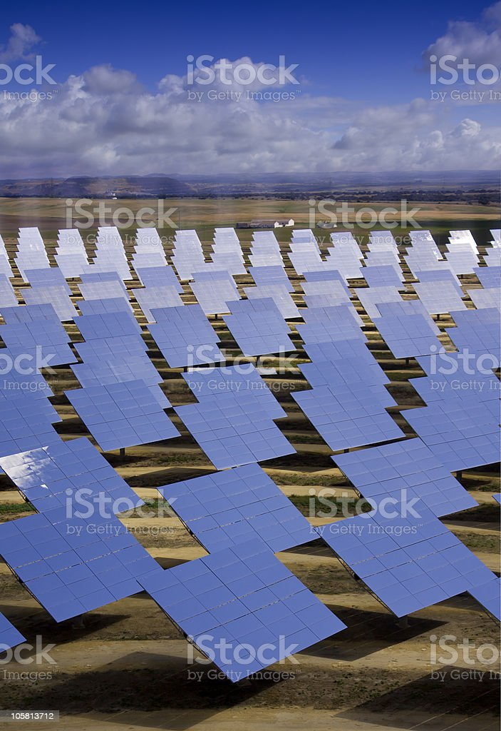 Solar heliostats for sun powered energy production stock photo