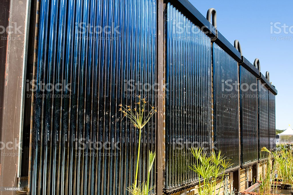 Solar Hot Water Heater Tubes with Gray H2O Recover System stock photo