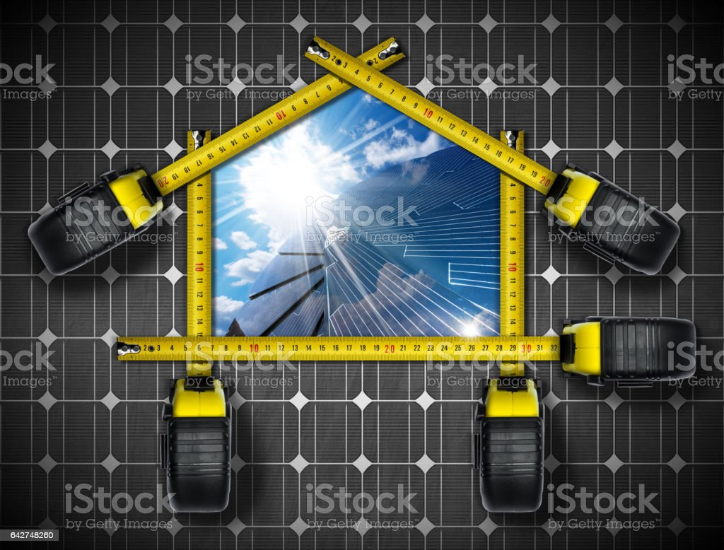 Tape measures in the shape of ecologic house with a solar panel, blue...