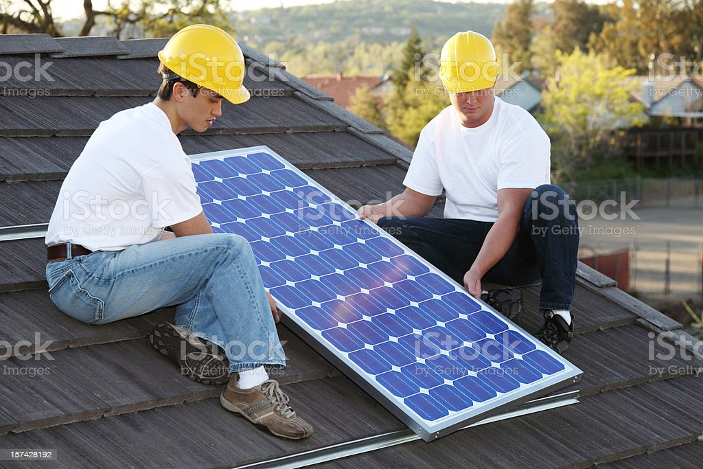 Solar Installers On Roof royalty-free stock photo
