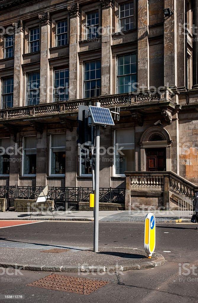 Solar panel and antenna on traffic light royalty-free stock photo
