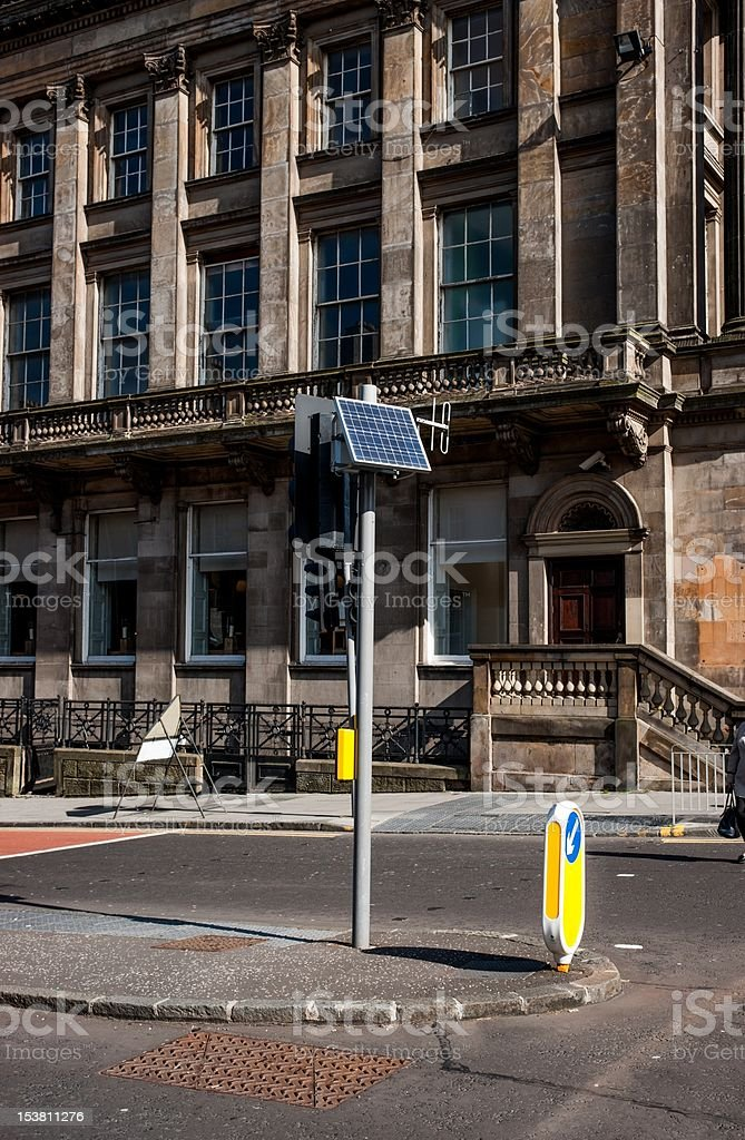 Solar panel and antenna on traffic light stock photo