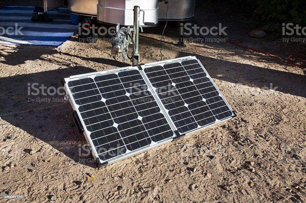 Solar panel by tiny camper stock photo