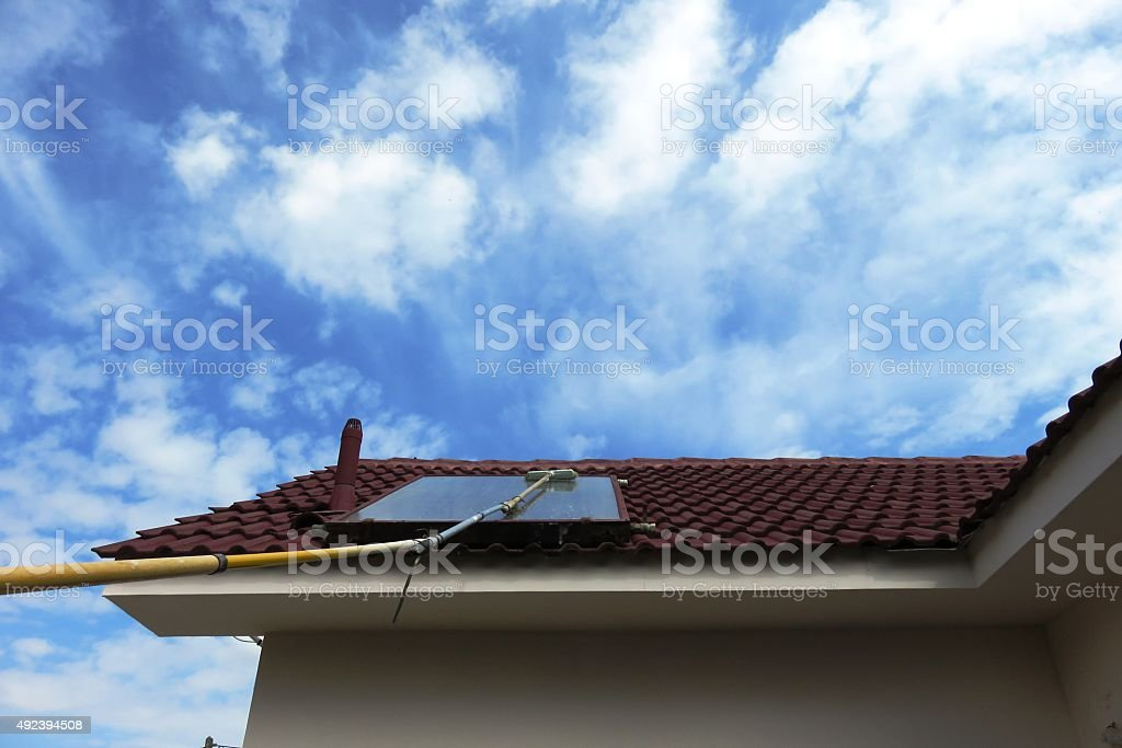 Solar panel cleaning with a makeshift broom stock photo