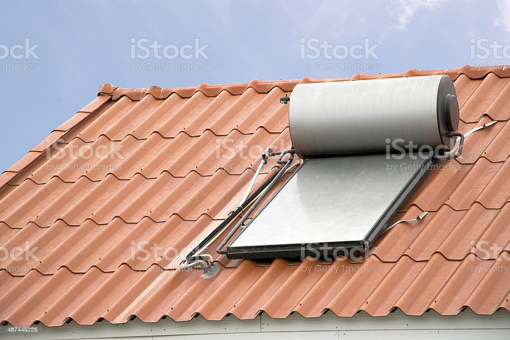 Solar panel for hot water system on roof royalty-free stock photo